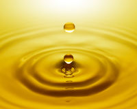 Golden water drop Stock Photography