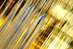 Golden water flow background stock photos