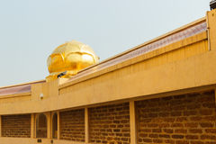 Golden water lily decorating on temple roof Royalty Free Stock Photo