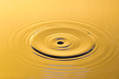 Golden water and water drop Royalty Free Stock Images