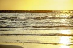 Golden water waves Stock Photo