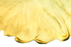 Golden watercolor drop. Abstract gold glittering textured art. W Royalty Free Stock Image
