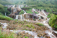 Golden Waterfall. Located near a gold mining area of Taiwan Royalty Free Stock Photography