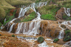 Golden waterfall on a mountain stock image
