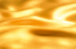 Golden wave of cloth Stock Image