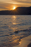 Golden Waves at Sunset Stock Image