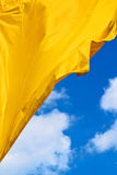 Golden waving flag Stock Image
