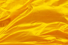 Golden waving flag Stock Photos
