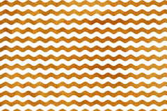Golden wavy striped background. Royalty Free Stock Photography