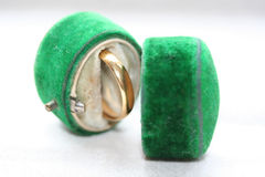 Golden wedding band in antique green velvet box. With copy space Stock Photography