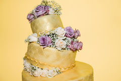 Golden Wedding Cake with Real Roses Stock Photography