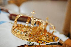 Golden wedding crowns at church ceremony. royalty free stock photography