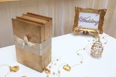 Golden wedding frame and three golden books Stock Image