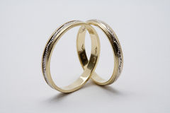 Golden wedding rings. On a white background stock photo