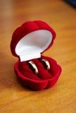 Golden wedding rings. In a red velvet box stock photo