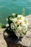 Golden wedding rings on bouquet. Golden wedding rings bouquet of white roses close-up Stock Photos