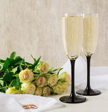 Golden wedding rings. A bouquet of white roses. Stock Photo