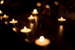 Golden wedding rings with candles. In the dark Stock Images