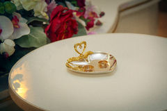 Golden wedding rings closeup. Pair of wedding rings in golden heart shaped box closeup royalty free stock images