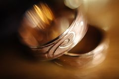 Golden Wedding Rings. Gold wedding rings with a pattern in the defocus Stock Photos