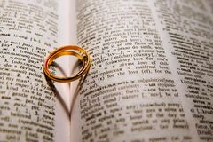 Golden wedding rings. With a shadow in the form of heart Royalty Free Stock Images