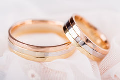 Golden wedding rings on lace Stock Images