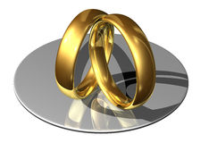 Golden wedding rings leaning against each other. On a white background royalty free illustration