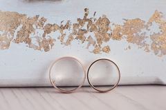 Golden wedding rings on a light background. royalty free stock photography