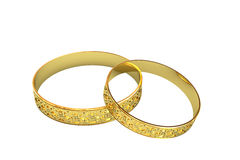 Golden wedding rings with magic tracery Royalty Free Stock Image