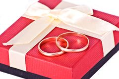 Golden wedding rings near the red gift box Stock Image
