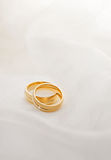 Golden wedding rings. A pair of golden wedding rings on white satin Royalty Free Stock Image