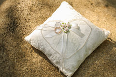 Golden wedding rings on a pillow. Royalty Free Stock Image