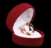 Golden wedding rings in red box. Isolated on black royalty free stock photos