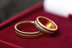 Golden wedding rings in a red box, close up. Golden wedding rings in a red box, close up royalty free stock photos