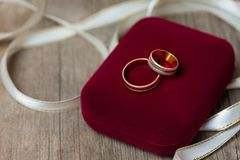 Golden wedding rings in a red box, close up. Golden wedding rings in a red box, close up stock photos