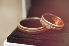 Golden wedding rings in a red box, close up. Golden wedding rings in a red box, close up stock images