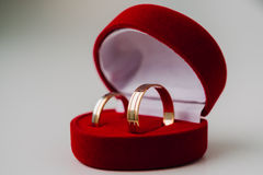 Golden wedding rings in red box the shape a heart Stock Photo