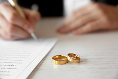 Golden wedding rings on table at notary office, Stock Images