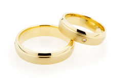 Golden wedding rings on white Royalty Free Stock Photo