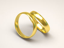 Golden wedding rings on white background Stock Photo
