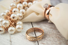 Golden wedding rings on white wood background Royalty Free Stock Photo