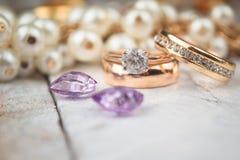 Golden wedding rings on white wood background Royalty Free Stock Photos