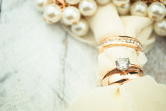 Golden wedding rings on white wood background Stock Image