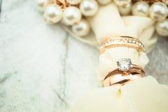 Golden wedding rings on white wood background Stock Image
