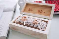 Golden wedding rings in a white wooden box. Wedding decoration. Symbol of family, unity and love Royalty Free Stock Photos