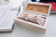 Golden wedding rings in a white wooden box. Wedding decoration. Symbol of family, unity and love Stock Photo
