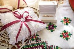 Golden wedding ringsin box near white pad pollow Stock Image