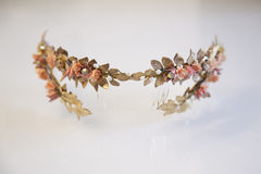 Golden wedding tiara with romantic flowers. Golden wedding tiara with romantic pink flowers Royalty Free Stock Images