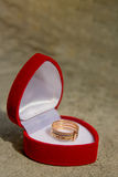 Golden week ring. In a red velvet gift box. White gold jewelry royalty free stock photo