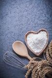 Golden wheat rye ears wooden spoon bowl flour egg whisk Royalty Free Stock Photo